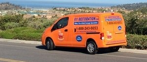 Water and Mold Damage Restoration Van Driving To Job Location