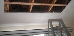 Mold and Water Damage Ceiling Restoration In Progress