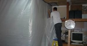 Technician Sealing In Mold With A Vapor Barrier