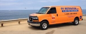 Water Damage Restoration Van Driving To Job Site